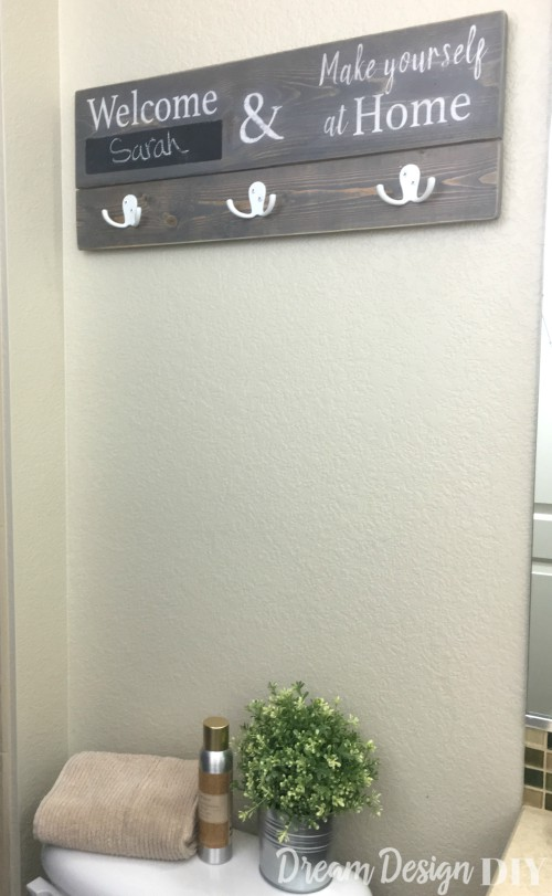 bathroom sign towel holder