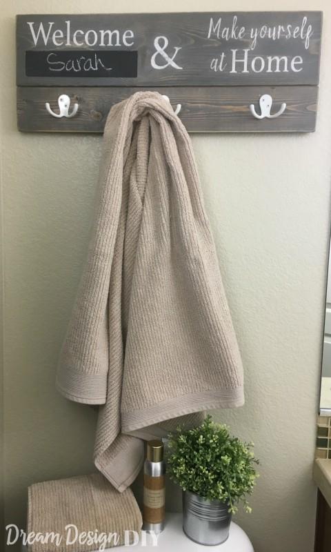 bathroom sign towel hanger