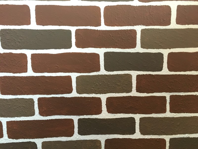 Here Is The Wall After All The Brick Was Stenciled.