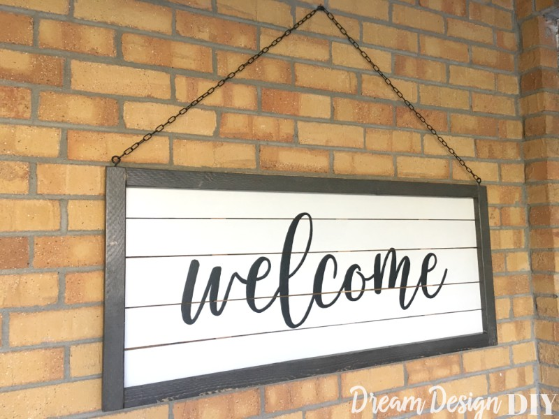 ISee how easy it is to get the look of shiplap with this DIY large framed shiplap welcome sign. Put your favorite words or quotes or display a wreath. Hang several in different sizes throughout your home. Get this easy tutorial to learn how to make your own. #shiplapsign #woodsign #farmhouse #diy
