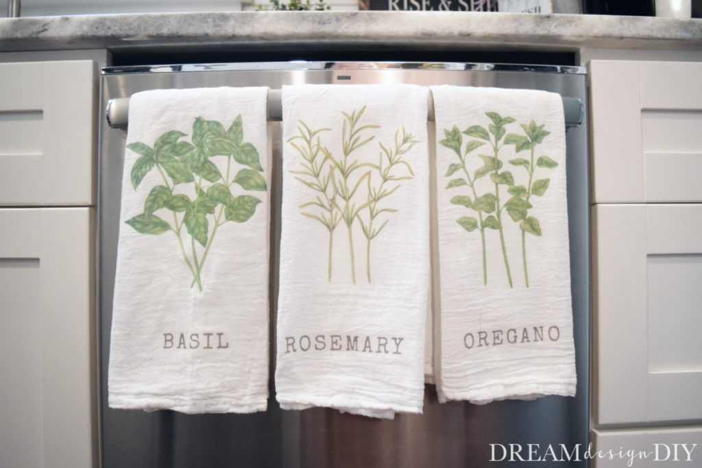 Make these easy DIY farmhouse kitchen herb towels using iron on transfer to fabric paper. Need more ideas? How about pillows, t-shirts, banners, kitchen and bathroom towels, and bags. This tutorial will show you how easy it is to do. #fabrictransfer #imagetransfer #ironontransfer #kitchentowels #farmhouse