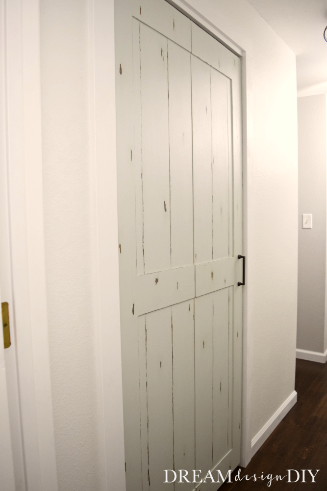 For $15 easily turn a bifold door into a barn door by adding a sheet of plywood. Great ideas for a bedroom, kitchen, hall, linen or laundry room closet or pantry. It adds a modern farmhouse style to the space. Add decorative door hardware to further enhance it's character. #barndoor #farmhouse #closet #bifolddoor #diy