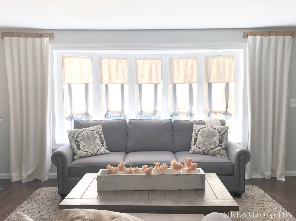 Buying ready made window treatments can be expensive. Make these DIY tie up shades and custom make them to fit any window. These shades are easy to make and forgiving for the beginning sewer, needing only a straight seam. #windowtreatments #tieupshades #diy #sewing #farmhouse #curtains