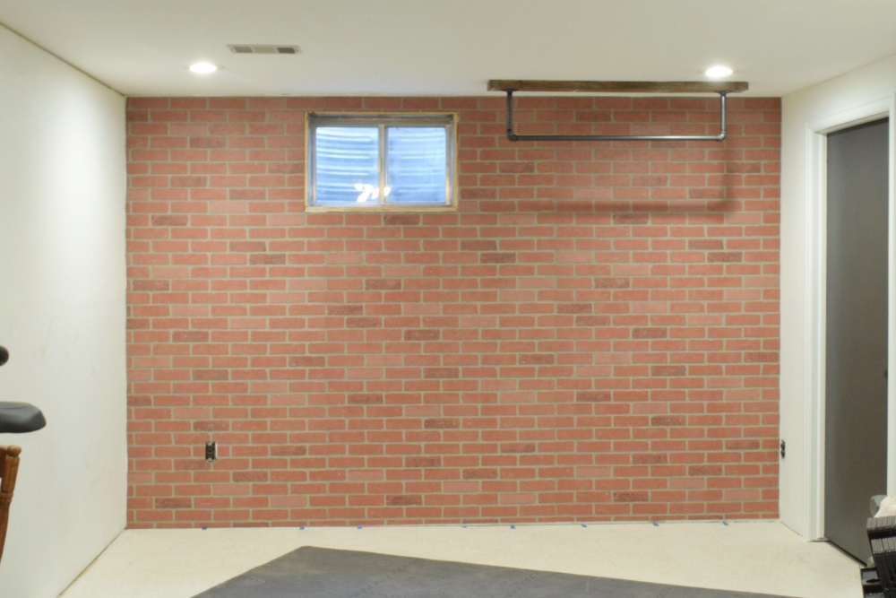 Add character to a room by installing faux brick panels. Add an accent wall with this is easy, budget-friendly DIY. Brick is classy, timeless and fits many different styles such as modern, traditional, industrial and farmhouse. You can paint it, add a German Smear, or whitewash it to change the look. #fauxbrick #brickpanel #diy #accentwall