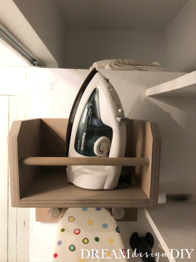 Make this iron, ironing board holder and add it to your laundry room for a stylish and functional way to store your ironing essentials. #diy #woodprojects #laundryroom